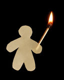 Paper man with burning wooden match stock photo