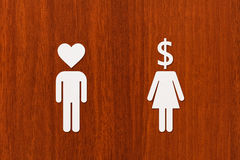 Paper man heart head and woman with dollar. Love vs money concept Royalty Free Stock Photography