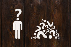 Paper man with question instead of head. Abstract idea concept Stock Photo