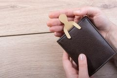 Paper man shape in wallet in hand stock photo