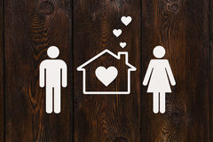 Paper man, woman and house. Housing, family concept. Abstract conceptual Royalty Free Stock Photos