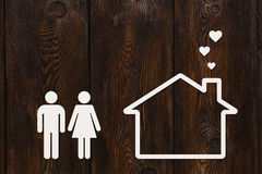Paper man, woman and house. Housing, family concept. Abstract conceptual Stock Images