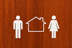 Paper man, woman and house. Housing, family concept. Abstract conceptual Stock Photos