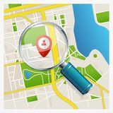 Paper map with magnifying glass and pin Royalty Free Stock Image