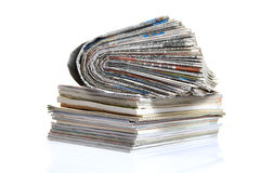 Paper media. Rolled newspaper and magazines isolated on white background Royalty Free Stock Photo