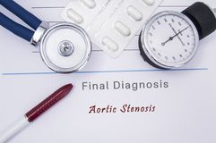 Paper medical form with the diagnosis of Aortic Stenosis on which lie the stethoscope, blood pressure monitor, white tablets or pi. Lls in a blister pack and a stock photos