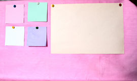 Paper for memos. Color sheets on the pink bulletin board Royalty Free Stock Photography