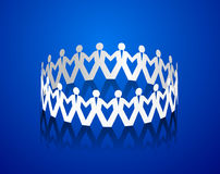 Paper men holding hands in the shape of a circle Royalty Free Stock Photo