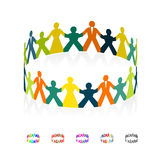 Paper men, women and children holding hands in the shape of a circle. Stock Image