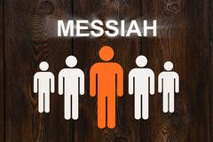 Paper men with word MESSIAH. Abstract conceptual image. Paper men on wooden background with word MESSIAH. Abstract conceptual image Stock Image