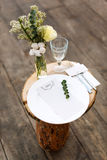 Paper menu on decorated table ready for dinner. Beautifully decorated table set with flowers, plates and serviettes for outdoor we Stock Image