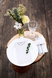 Paper menu on decorated table ready for dinner. Beautifully decorated table set with flowers, plates and serviettes for outdoor we Stock Photography