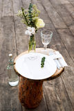 Paper menu on decorated table ready for dinner. Beautifully decorated table set with flowers, plates and serviettes for outdoor we Stock Images