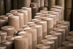 Paper mill factory. Storage of produced paper rolls royalty free stock photos