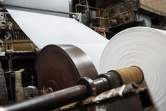 In the paper mill machines. Paper mill in papermaking machine royalty free stock images