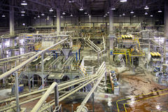 Paper Mill - Pulping department. Paper mill is a factory devoted to making paper and cardboard from recycled paper using pulper and Fourdrinier Machine royalty free stock photography
