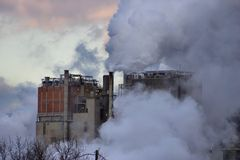 Paper Mill and Steam. A paper mill shrouded in smoke or steam Stock Images