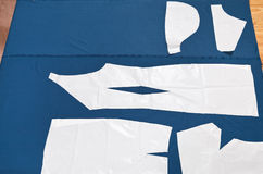 Paper model of apparel on fabric for cutting Stock Photos