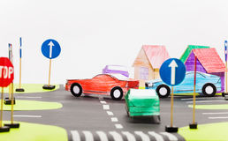 Paper model of busy crossings in toy city. Picture of handmade paper cars at the busy crossings of toy city with copy-space Royalty Free Stock Photography