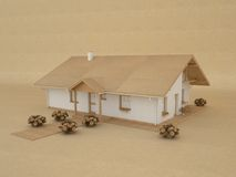 Paper model house. Model house made of recycled paper, brown background Royalty Free Stock Images