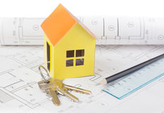 Paper model of the house costs on the construction plan Royalty Free Stock Image