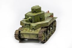 Paper model of an old battle tank isolated on Royalty Free Stock Photo