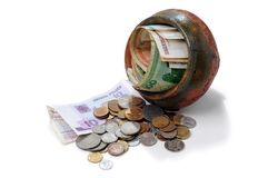 Paper money. And lot of coin's in clay pot, on white background Stock Images