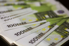 Paper money banknote 100 euro. Paper money banknote bill of 100 euros on a black background Stock Photography