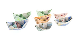 Paper money boats Stock Photos
