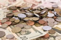 Paper money and coins of different countries. Paper money and coins of the different countries Stock Photos