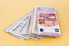 Paper money and coins of different countries. Paper money and coins of the different countries Stock Images