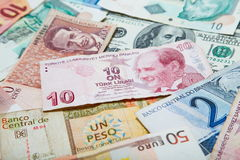 Paper money of the different countries. Turkish lira in the middle. Background from paper money of the different countries. Turkish lira in the middle Stock Image