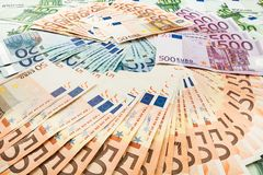Paper money euro. background of banknotes. Paper money euro and hryvnia. background of banknotes for the screen saver on the monitor Royalty Free Stock Photo