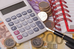 Money, pen and calculator Royalty Free Stock Image