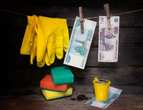 Paper money and gloves hanging on the rope. Laundering of money Stock Photography