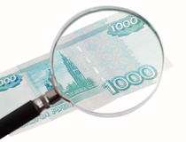 Paper money increased magnifying glass Royalty Free Stock Photos