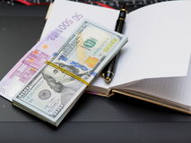 Paper money, notebook, handle Royalty Free Stock Photo