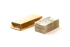 Paper money from poland and bar of gold Stock Photo