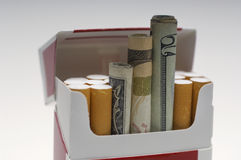 Paper Money Rolled Up In Cigarette Box Royalty Free Stock Photo