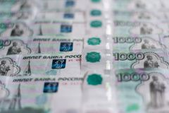 Paper money, Russian rubles, thousandth notes are spread out in order, the money background stock image