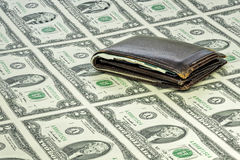 Paper money in a sheet with an old leather wallet Royalty Free Stock Photo