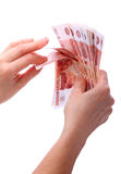 Paper money in their hands Stock Photography