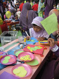 Paper mozaic. Children make paper craft mosaic outside the classroom in the city of Solo, Central Java, Indonesia Royalty Free Stock Photo
