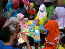 Paper mozaic. Children make paper craft mosaic outside the classroom in the city of Solo, Central Java, Indonesia Royalty Free Stock Photos