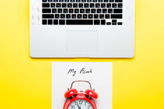 Paper My Book, alarm clock and laptop Royalty Free Stock Images