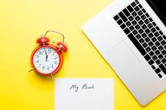 Paper My Book, alarm clock and laptop Stock Photos