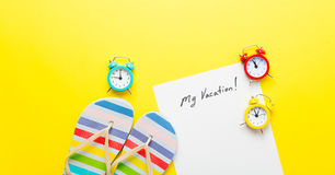 Paper My Vacation, alarm clocks and sandals Royalty Free Stock Photo