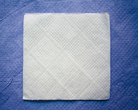 Paper napkin on blue napkin background Royalty Free Stock Image