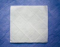 Paper napkin on blue napkin background Royalty Free Stock Image