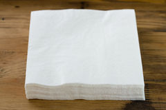 Paper napkin on brown background Stock Images